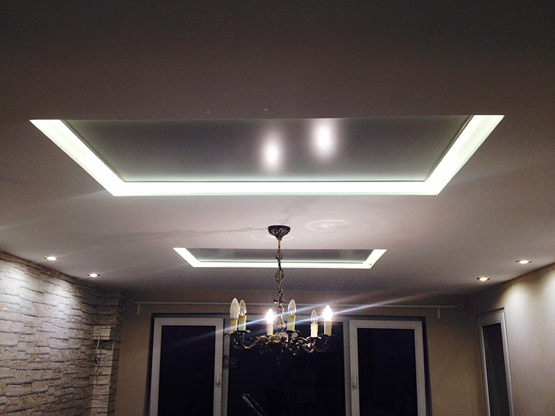 Two infrared heating panel installed on the ceiling in a living room 20 м2