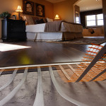 Mats for underfloor heating under laminate and solid wood