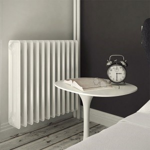 Cast iron heating radiator installed in the bedroom