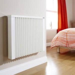 Steel heating radiator installed in bedroom