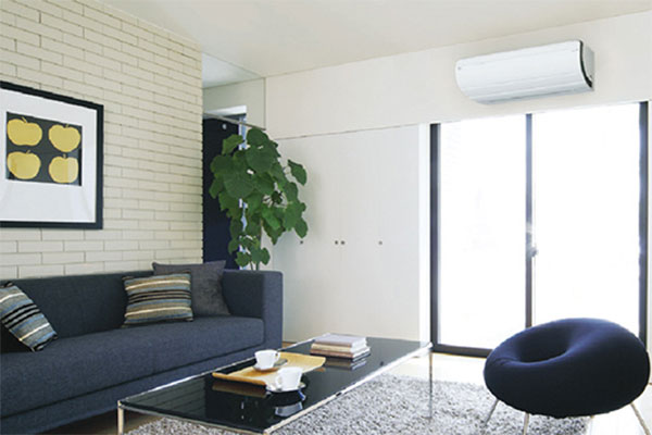 Air conditioning Daikin installed in living room for heating and cooling - illustration