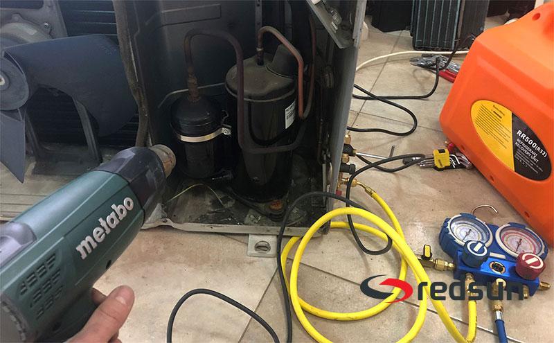 Обдухване на компресора на климатика с пистолет за горещ въздух